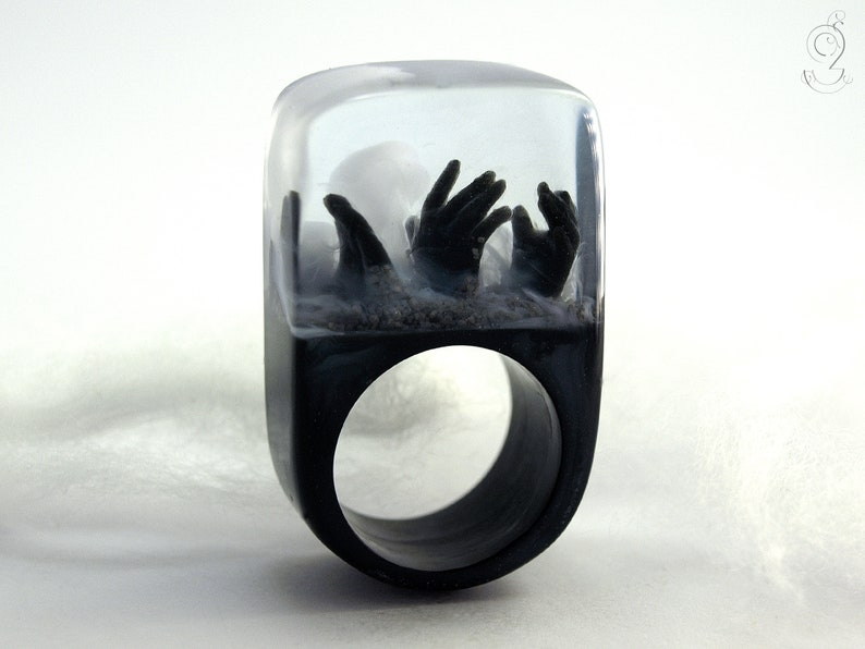 Zombie  creepy undead ring with three black hands and fog on image 1