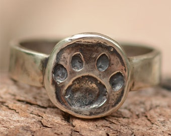 Items similar to Paw print ring sterling silver on Etsy
