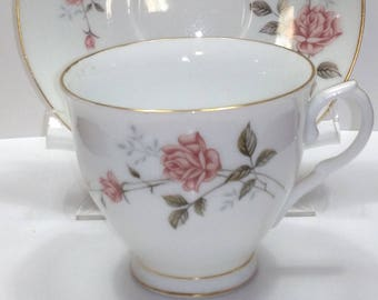 Porcelain Gold Trimmed Cup and Saucer set with light red roses  China