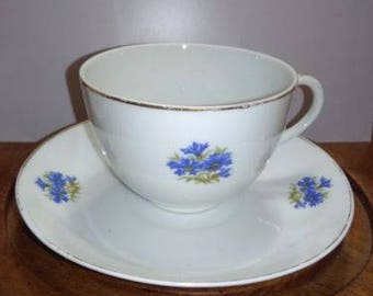 Gold-Trimmed Teacup and Saucer with Small Blue Flowers