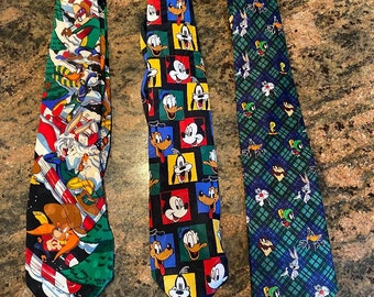 Looney Tunes  Mens  Neck Tie Featuring Taz Tweety Bird Sylvester the Cat Bugs Bunny Daffy Duck