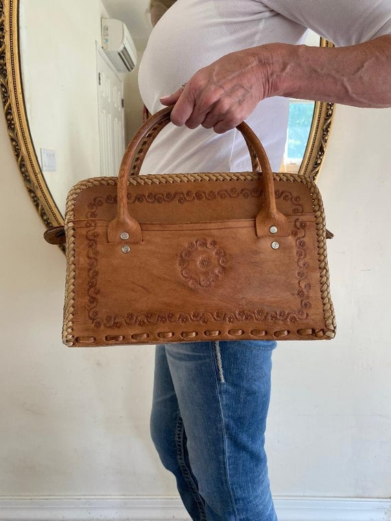 Tooled leather purse, bag, top handles