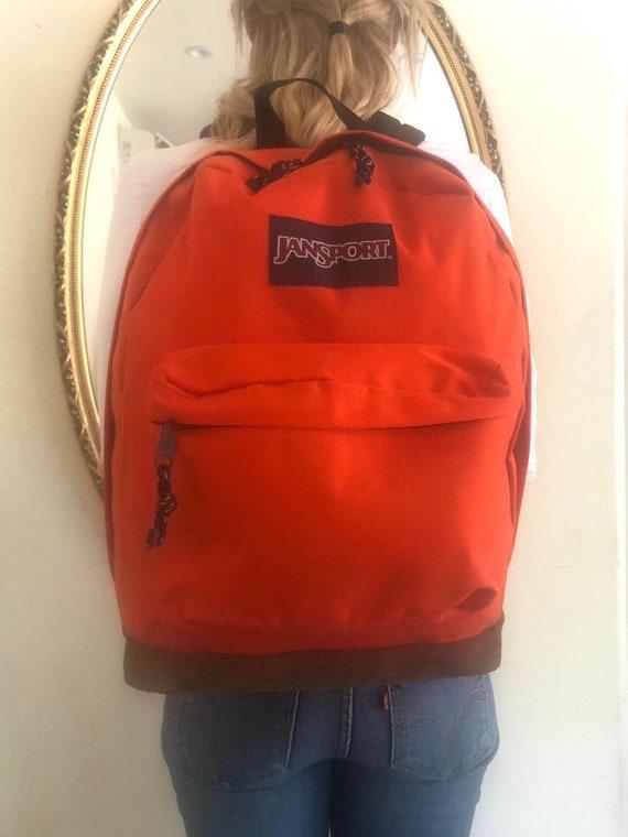 Orange Jansport backpack,Leather Bottom,Backpack b
