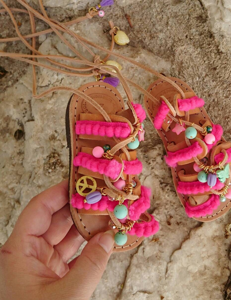 fa86a651dd85f Pom Pom Wonderland Charm Kids Sandals   Gemstone Charms   Cotton Pom pom  Lace   Baby Lace up Sandals   Handmade Gladiator Sandals