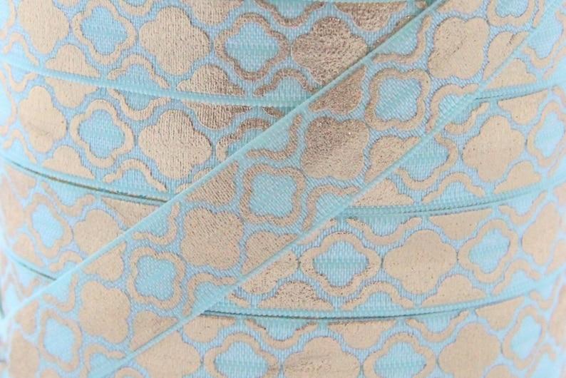 Aqua Metallic Gold Quatrefoil Print Fold Over Elastic  image 0
