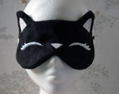 Sleepy black kitty face mask