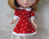 Blythe puffed sleeved red dress.
