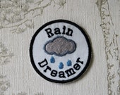 Embroidered weather merit iron on patch: Rain Dreamer