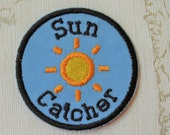 Embroidered weather merit iron on patch: Sun Catcher