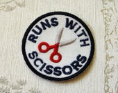 Crafting merit embroidered iron on patch: Runs with scissors.