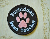Embroidered iron on merit patch: Forbidden bean toucher.