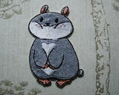 Tam the Tiny Hamster Smug face embroidered iron on patch.