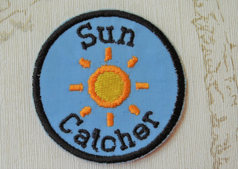 Embroidered weather merit iron on patch: Sun Catcher image 0