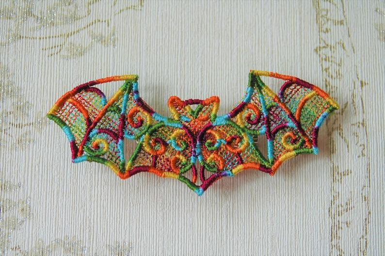 Rainbow Pride Bat lacework brooch. image 0