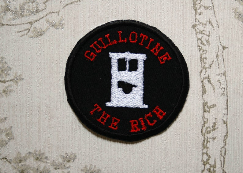 Whimsy merit embroidered iron on patch: Guillotine the rich. image 0