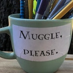 Muggle, Please. (supply holder)