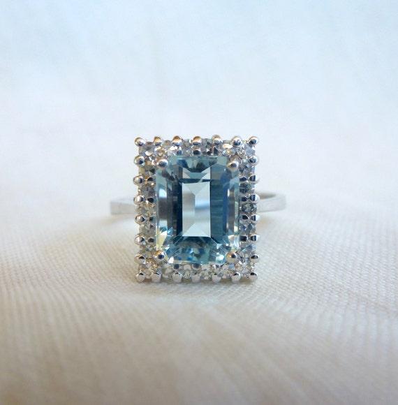 A Natural Emerald Cut Aquamarine and Diamond Halo Engagement Ring in 14kt White Gold - Bethany