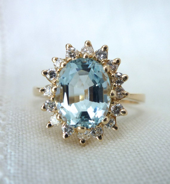 A Natural Aquamarine and Diamond Flower Halo Ring in 14kt Yellow Gold - Saratoga