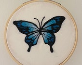 Embroidery Blue butterfly in embroidery ring