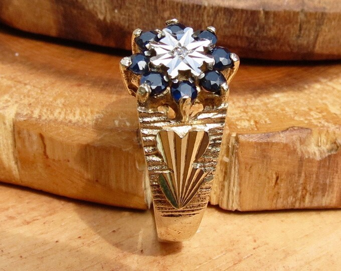 Gold sapphire ring. A Vintage 9K yellow gold sapphire and diamond daisy ring.
