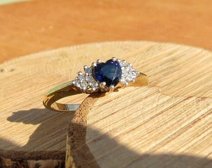 Petite 9k yellow gold heart cut blue sapphire and diamond ring.