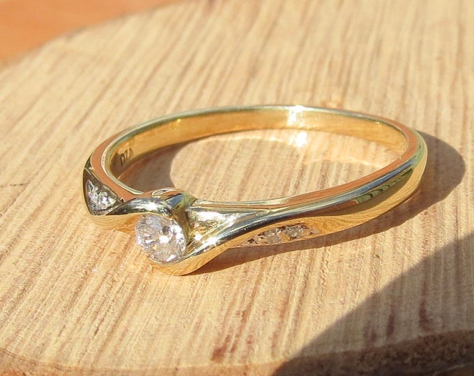 Gold diamond ring. 9K yellow gold solitaire diamond ring.
