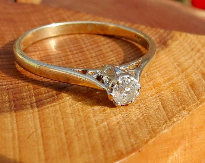 1/10 Carat diamond solitaire 9k yellow gold ring.