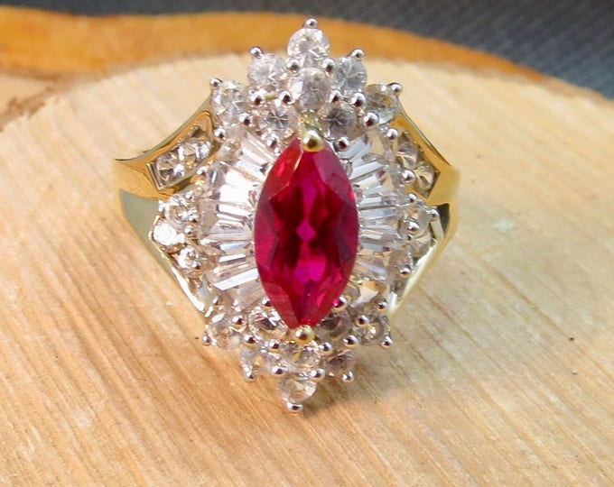 A 10K yellow gold synthetic ruby and white stone ring cocktail ring.