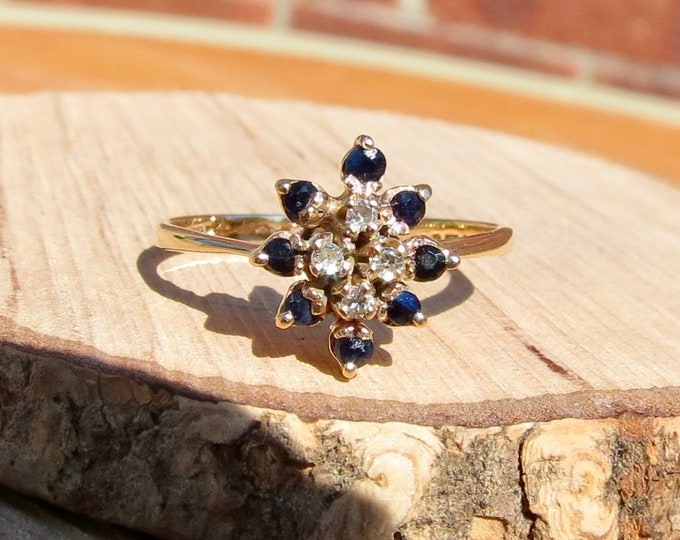 Little 1960s 9K yellow gold sapphire and diamond daisy ring.