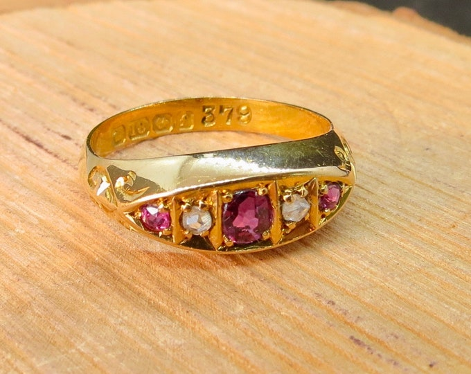 A petite antique 18K yellow gold 'old mine cut' diamond and ruby ring, made in 1905