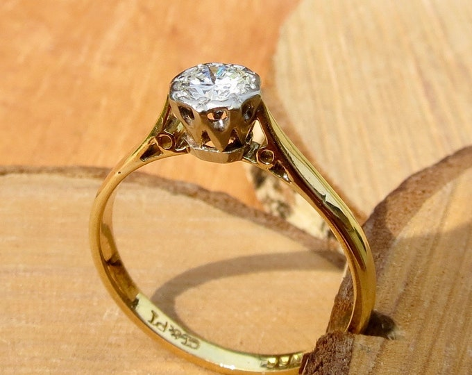 An 18K yellow gold and platinum 1/2 Carat diamond solitaire ring.