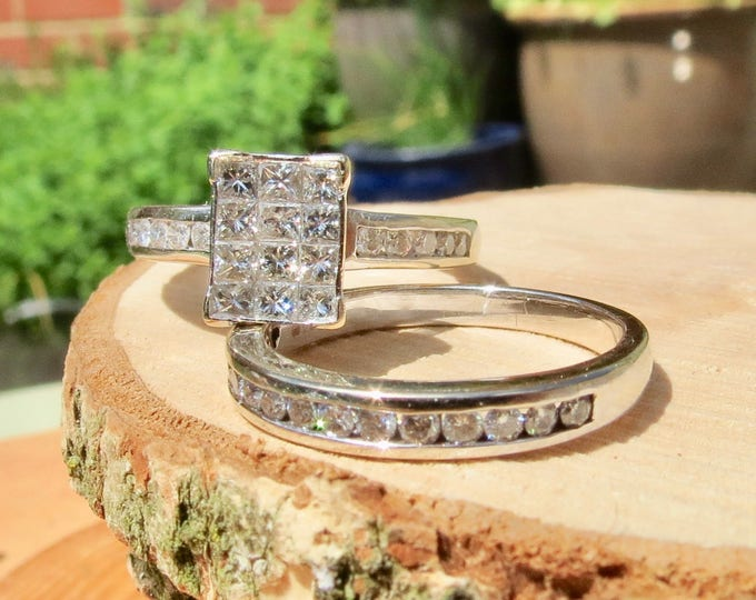 A pair of 18k white gold princess cut diamond rings, a total of 1 Carat white diamonds.