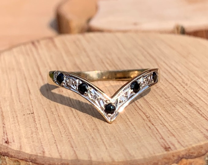 Gold sapphire ring. A 9k yellow gold blue sapphire and white and diamond wishbone ring.