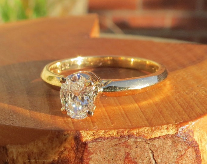 Diamond gold ring. 1/2 Carat 18k yellow gold oval cut multi-faceted solitaire diamond ring. Petite with free resizing.