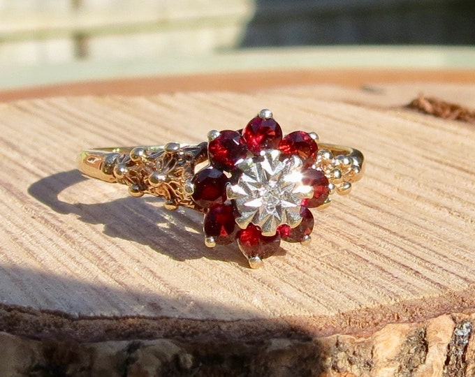 Vintage 9K yellow gold red garnet and diamond daisy ring from 1977