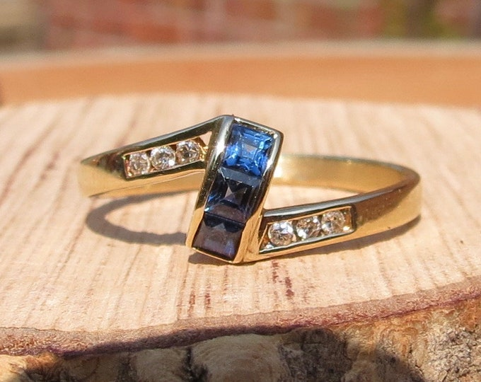 Gold sapphire ring. A 14k yellow gold blue sapphire and diamond ring