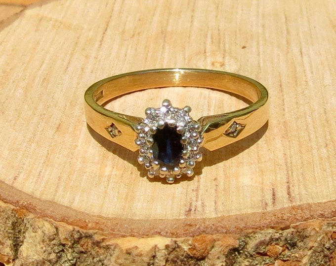 A vintage 9k yellow gold blue sapphire and diamond ring.