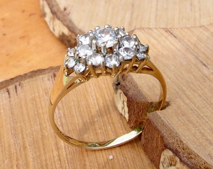 A 9K yellow gold 1.3 carat cubic zirconia cluster ring.