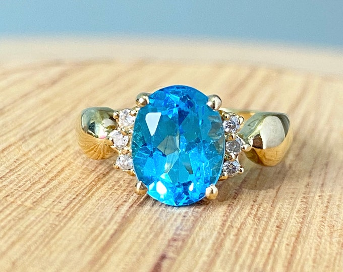 Gold topaz ring. 9K yellow gold 1.7 carat London blue topaz with diamond accents. Petite size.