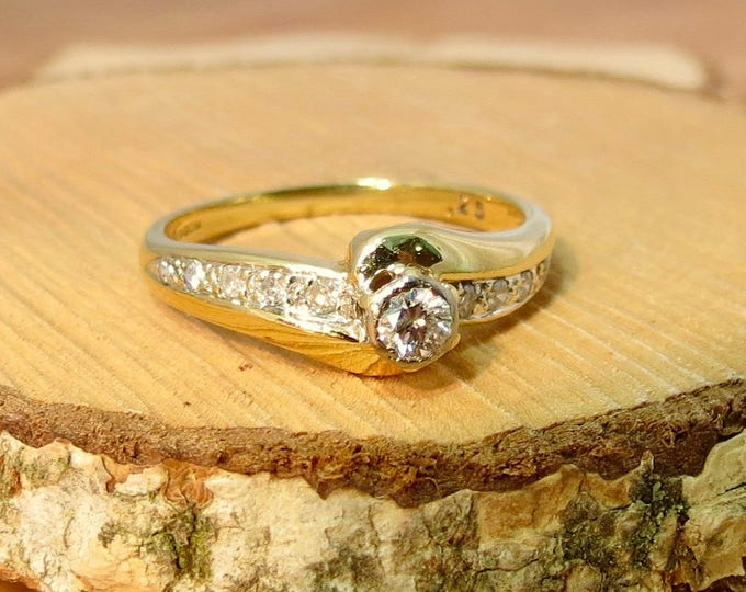 A vintage 18k yellow gold 1/4 Carat diamond solitaire ring.