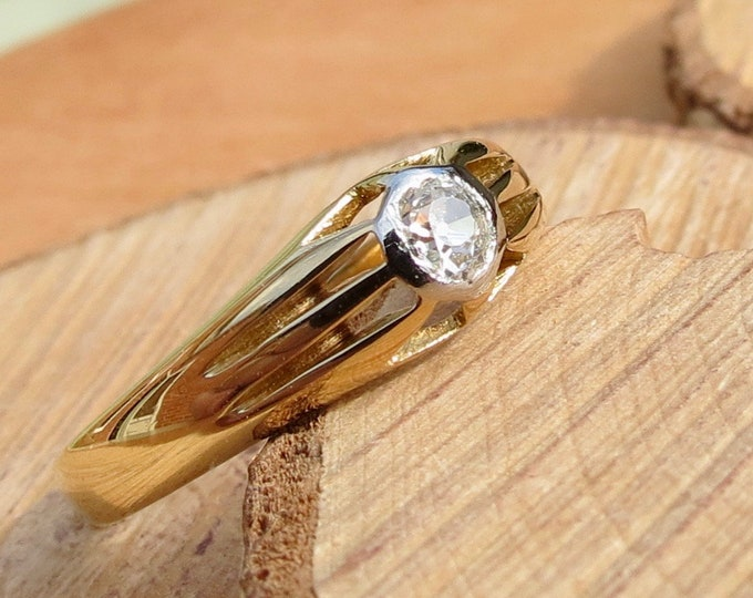 A vintage platinum and 18K yellow gold 1/5 carat 'old mine cut' diamond solitaire ring.