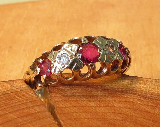 A vintage 9K yellow gold diamond and ruby ring.