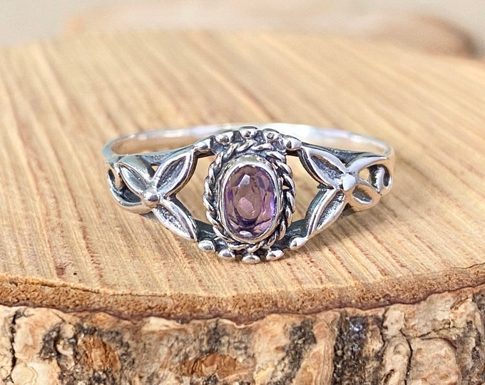 Silver ring, Purple amethyst with lily flower accents. Symbolising purity.