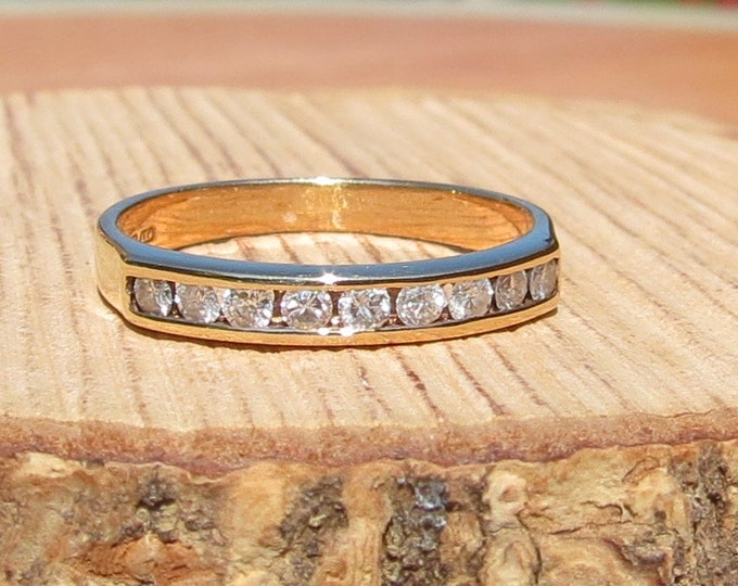 Gold diamond ring. Petite 9K yellow gold 9 diamond ring. Would fit a young person, perhaps even a child