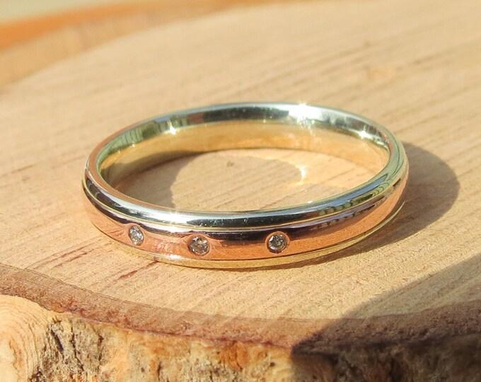 Gold diamond ring, Scottish 9k rose and white gold ring with three brilliant cut diamonds.