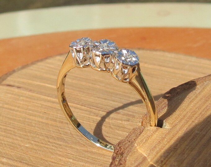 Gold diamond ring. A little 9k yellow gold diamond trilogy ring
