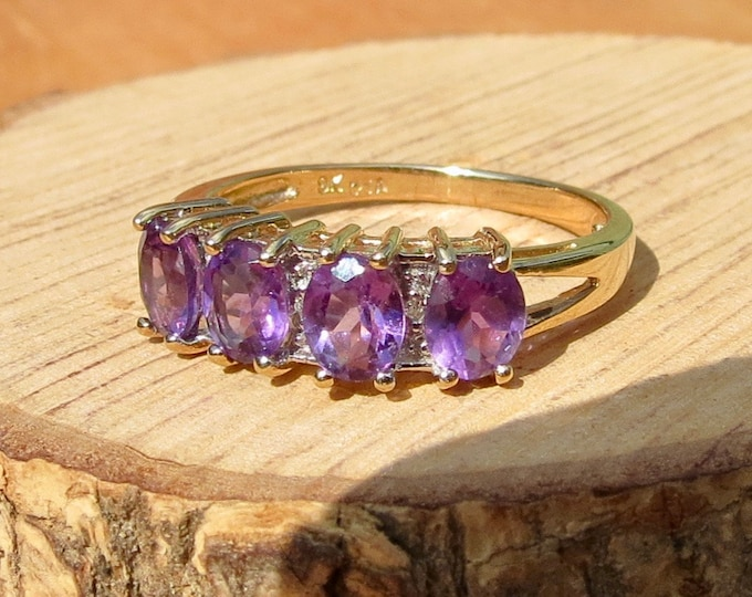 A 9k yellow gold 5 stone amethyst and diamond ring