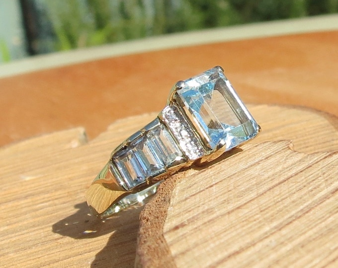 Gold topaz ring. A 9k yellow gold 3 carat sky blue topaz and diamond ring