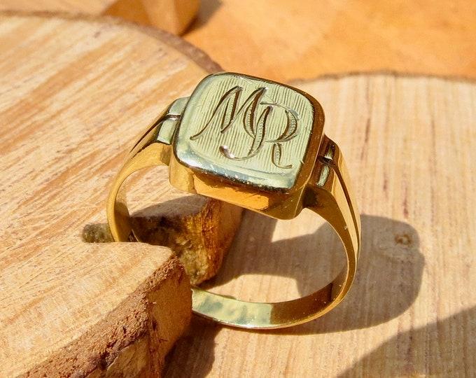 14K yellow gold engraved signet ring.