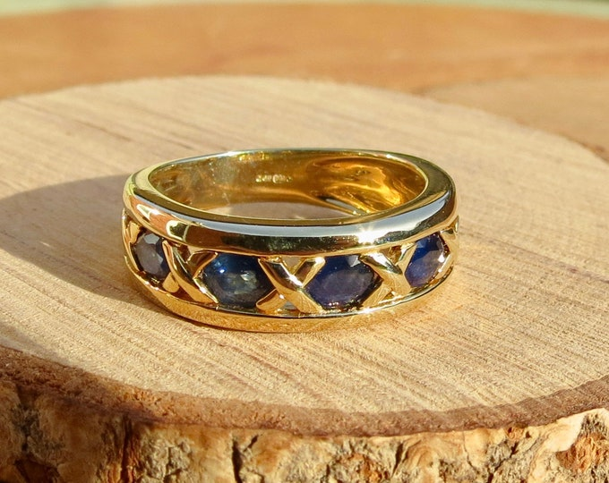 Gold sapphire ring. 9k yellow gold 2 1/2 carat five stone sapphire ring